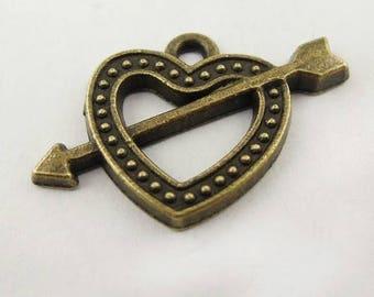 4 heart charm and bronze metal arrow