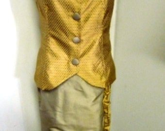 This is a gold toned silk two piece ensemble with a vest and wrap skirt