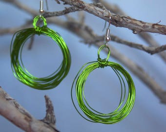 Green hand coiled wire hoop earrings