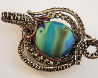 Copper woven & wrapped etched blue multi color wave design lampworked bead pendant