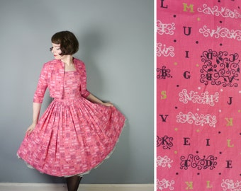50s pink NOVELTY dress with matching bolero jacket by REMBRANDT - typeface LETTER alphabet print - full skirt Mid Century cotton dress - s-m