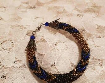 Black, blue and gold bead crochet rope bracelet.