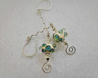 Blue and bumpy lampwork glass beaded earrings with sterling silver wirework accents can be both dressed up and down, versatile
