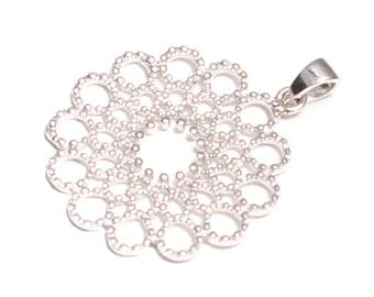 Fancy mandala pendant in sterling silver