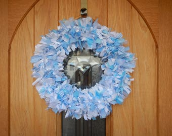 Precious Baby Blue Interior decor wreath with white,blue and silver ribbons,material and lace