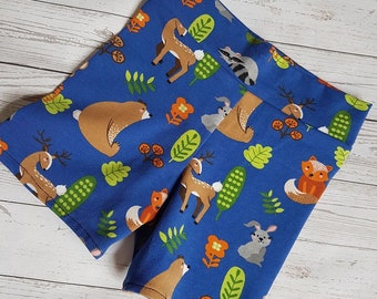 Cute little handmade shorts. Made in a quality soft jersey fabric.  Base colour is mid blue with bright animals on.