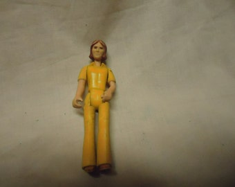 Vintage 1974 Fisher Price Action Figure, collectable. Hong Kong, woman in yellow