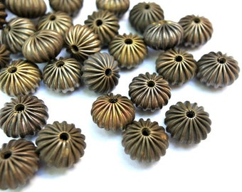 6 Vintage metal beads 14mmx9mm