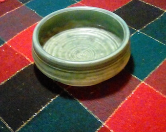 ceramic bowl with green crawling glaze