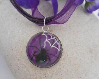 C32 - Necklace black spider on purple background