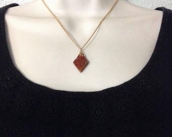 Vintage brown moss agate jewelry set on original cardboard.
