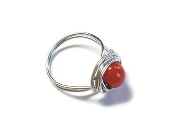 Silver wire wrapped ring with orange red glass stone