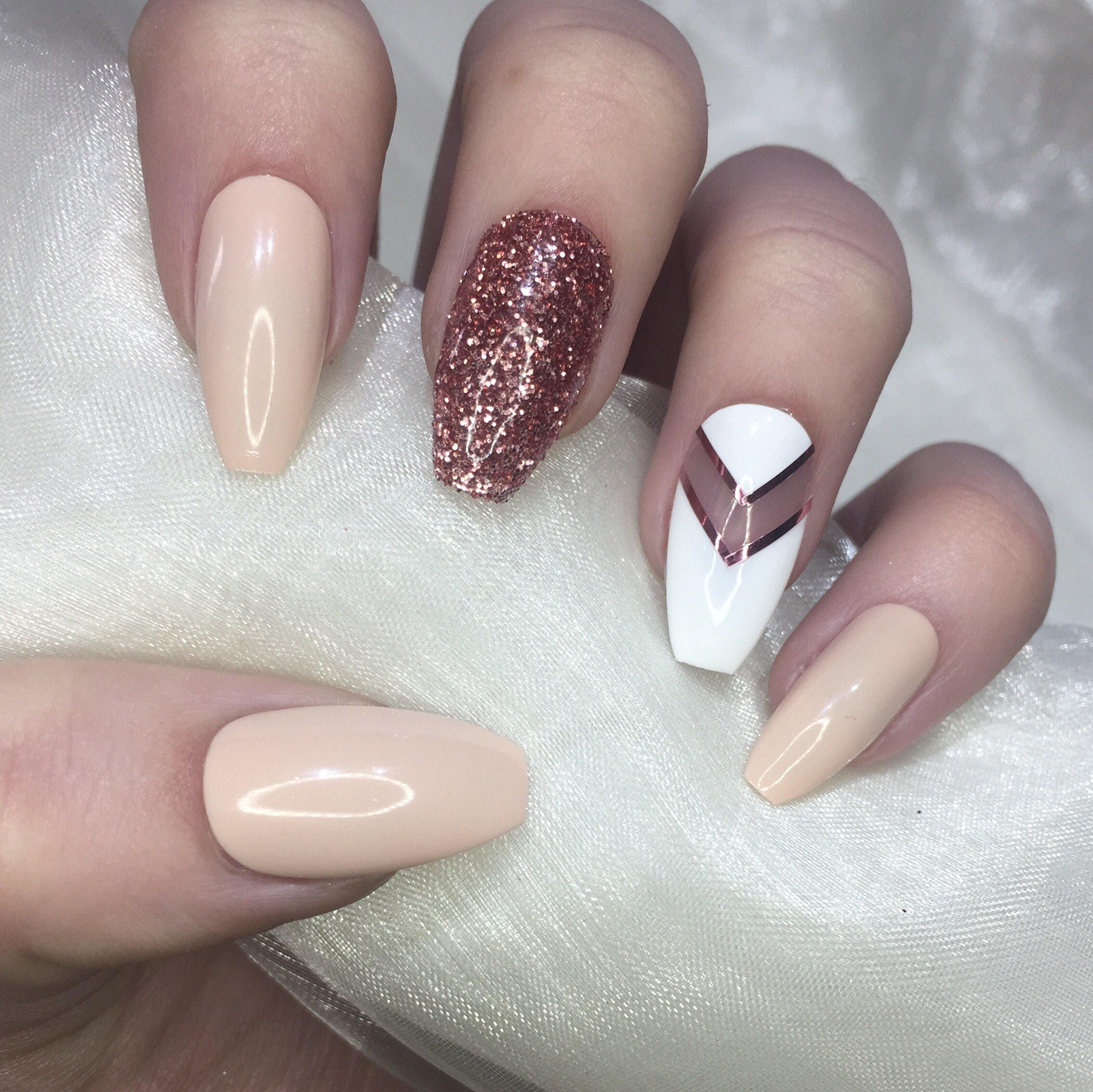 Nude and rose gold glitter coffin nails