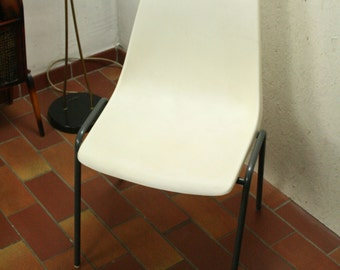 vintage white molded plastic stacking chair by Kusch + Co