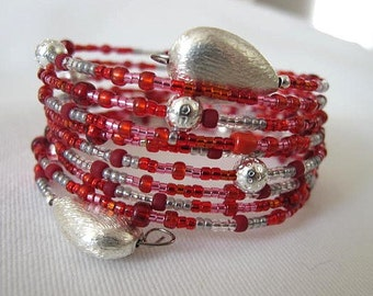 Red GYPSY bracelet wide wrap around bangle bracelet. Red and Silver toned  beads. With fat drop silver end beads