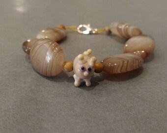 Cream bracelet with glass cat