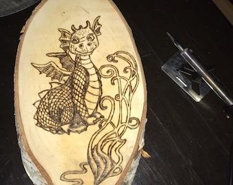 Dragon on birch wood