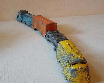 Reduced. Toy train, metal, uncouples