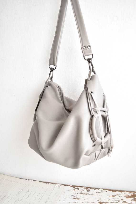 Byloom and Hyde pale grey leather slouchy leather shoulder bag.