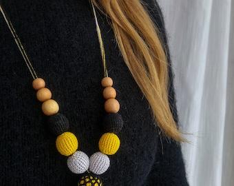 Nursing Necklace / Babywearing Necklace - yellow and black - juniper wood