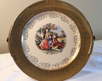 Vintage Sabin Crest-O-Gold Warranted 22 KT Etched Gold and Porcelain Courting Couple Plate with Handle Hanger Stand