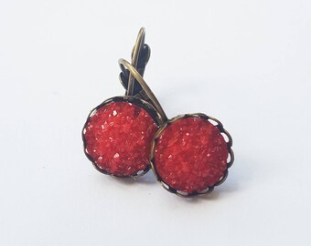 Red faux druzy lever back earrings .