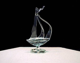 Sail boat wedding cake top with three sails.