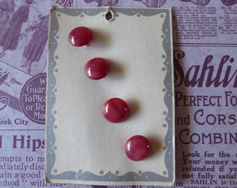 Vintage card of 4 maroon shank buttons