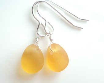 Seaham Sea Glass hook earrings of yellow gold drops suspended from Sterling Silver hooks - E1794 - from Seaham,  UK