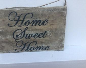 "Vintage ""Home, Sweet, Home"" sign."