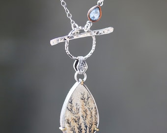 Natural Dendritic quartz pendant necklace set in silver bezel and brass prongs setting with blue topaz on the side on oxidized silver chain