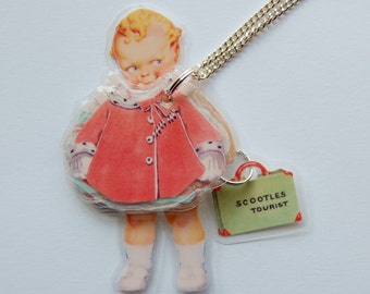 Baby Tourist Scootles Paper Doll Laminated Necklace