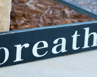 Breathe wood sign, black and white
