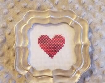 Framed pink cross stitch heart