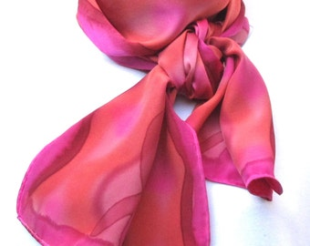Painted charmeuse silk scarf in magenta, burgundy, gold, burnt orange, and fuchsia.  Hand painted satin scarf in bright warm colors.