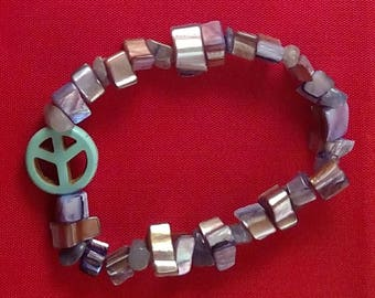 Metallic bead bracelet with Turquoise peace sign charm