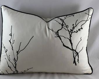 Ivory linen cushion with black twigs print and black piping