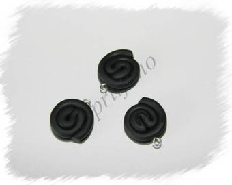 """""""Roll of licorice"""" charm in polymer clay"""