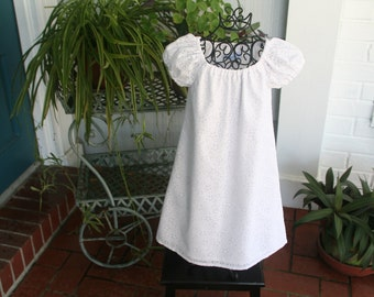 Handmade Flower girl white dress in a beautiful fabric   Available in sizes 1 thru 6