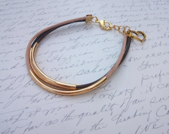 Leather wrap bracelet with gold tubes
