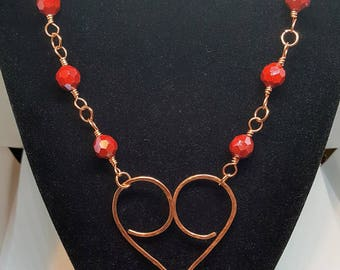 Copper heart and coordinating chain embellished with red faceted beads