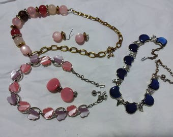 Pretty vintage group of necklaces two with matching earrings. Estate found costume jewelry pinks and blues.
