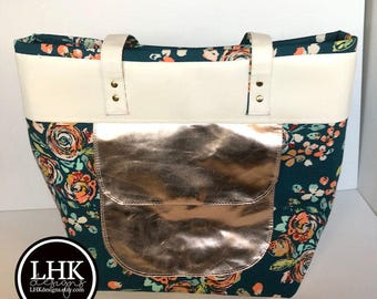 Large tote bag with rose gold accent and plenty of pockets