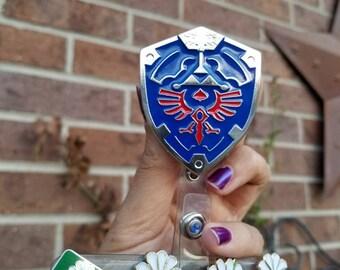 The Legend of Zelda Hylian shield badge reel clip. Zelda retractable badge id holder. Comes with reel. BadgeBlingCS. Triforce