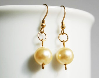 Gold and cream pearl earrings