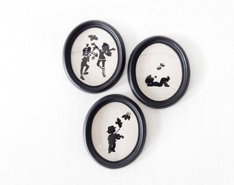 Vintage Frames Handmade Cut-out of Kids Playing in Black and White