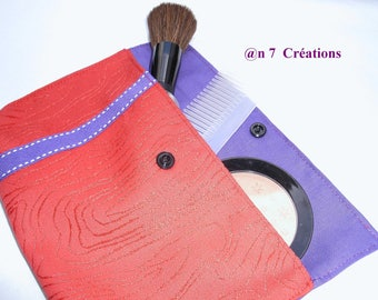 Small pouch, orange and purple 21 cm by 11 cm to slip into the purse.