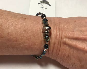 Black rainbow beaded wire bracelet with silver beads and larger faceted rainbow beads 7.5 inches long with silver tone clasps
