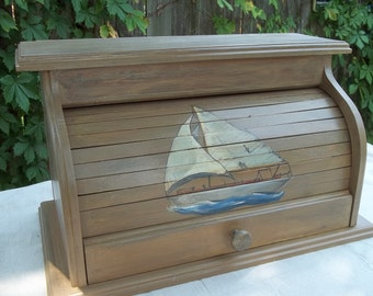 Bread box with sailboat hand painted on the roll top door with a glaze over top