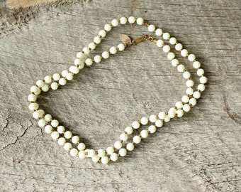 signed Miriam Haskell necklace . white bead strand necklace . vintage designer jewelry